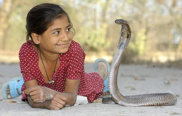 Girl-Playing-with-Cobra-snake